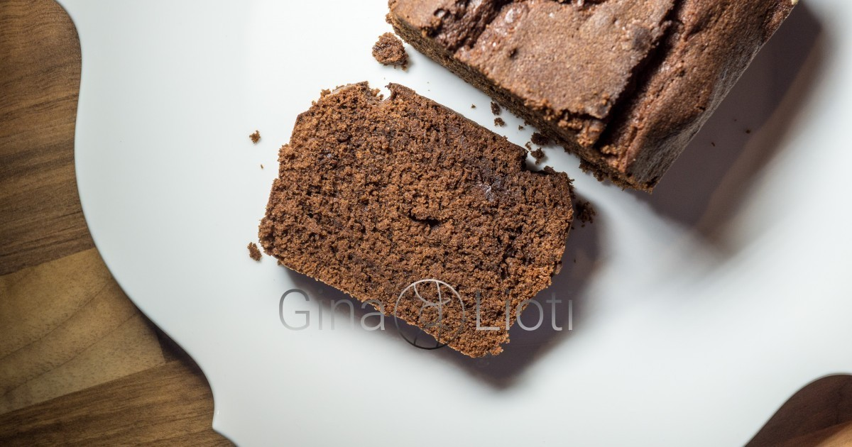 A chocolate cake slice, next to the loaf cake