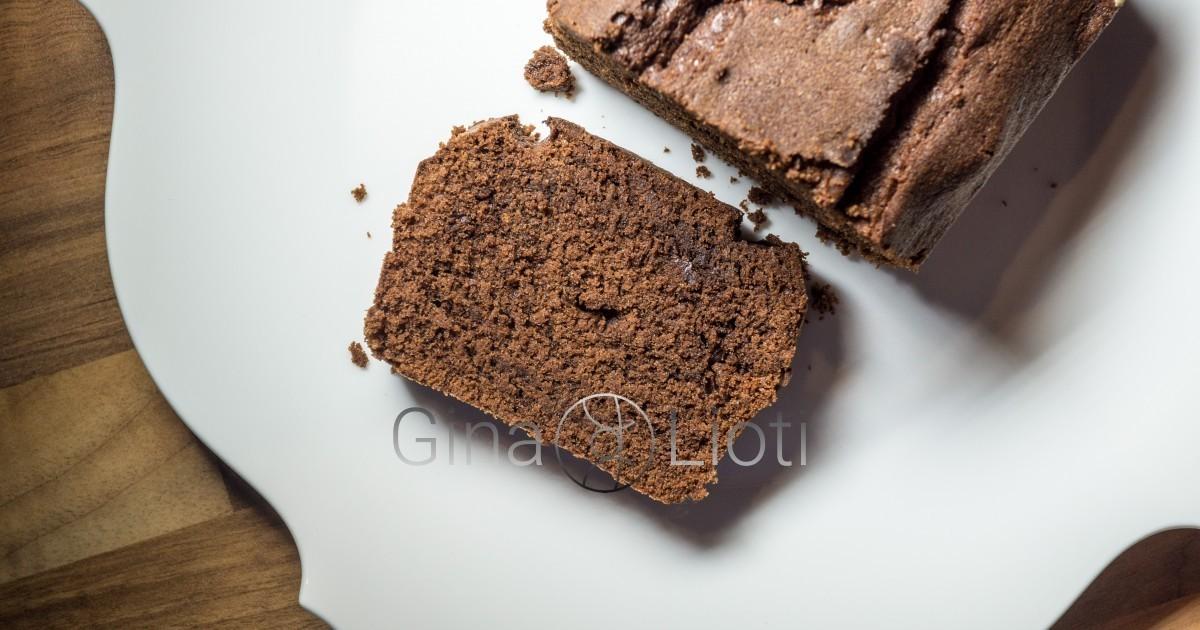 A chocolate cake slice, next to the loaf cake